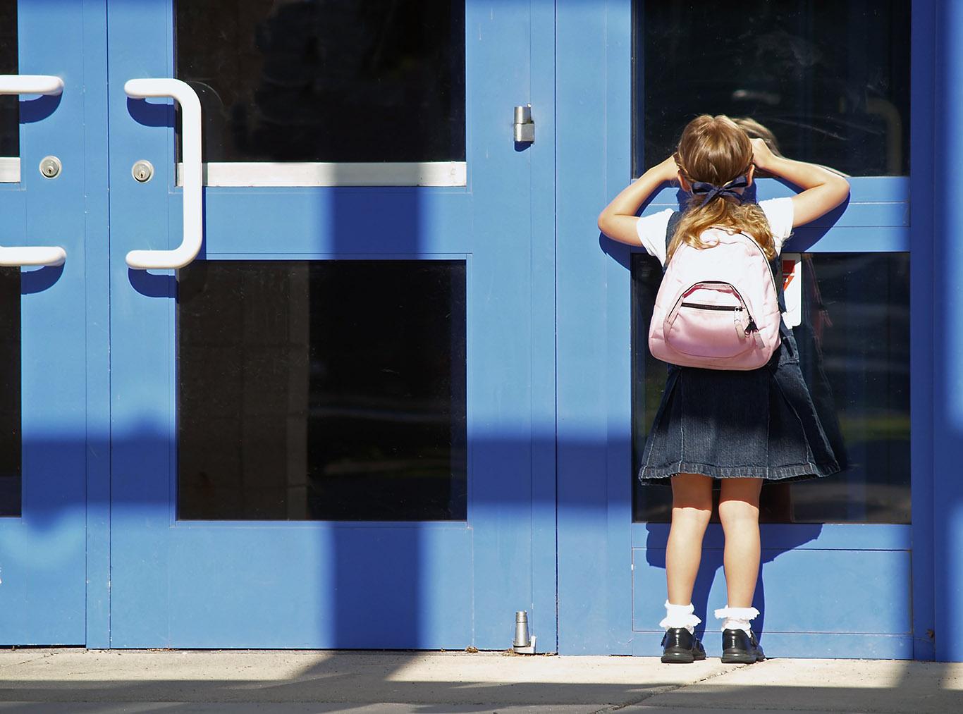 New student at school door.